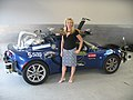 "Sherry standing in front of the ""Lone Wolf,"" a Lotus Elise sports car. (930725476).jpg"