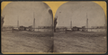 Small sailing ships moored for loading and railroad bridge over the Connecticut River in the background, by McIntosh & Camp.png