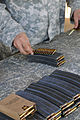 Soldier with the 101st Troop Command load ammo for weapons qualification, at Camp Santiago Joint Maneuvers Training Center, Salinas, Puerto Rico, Dec. 2, 2012 121202-A-OU224-114.jpg