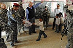 Soldiers, Iraqi national policemen distribute school supplies in Baghdad DVIDS157249.jpg