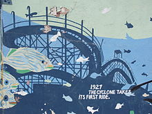 Wall of the New York Aquarium, with blue-painted fish and the Cyclone
