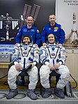 Soyuz MS-04 crew members with their backups in the Integration Building.jpg
