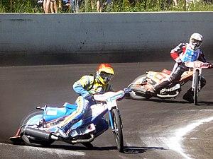 Broadsiding - Riders sliding their bikes around a bend