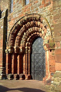St Bees Priory westdoor evening sun.jpg
