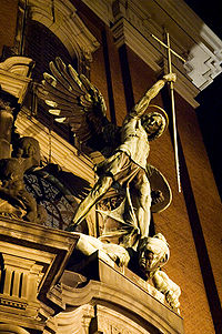 Statue of Archangel Michael over the main Gate of the church Sankt Michaelis in Hamburg Germany