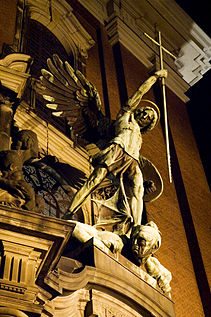 Statue of Archangel Michael over the main Gate of the church Sankt Michaelis in Hamburg Germany.jpg