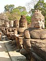 Statues over a bridge-angkor.jpg