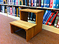 Stepstool for reaching books at library.jpg