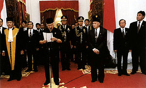 Fall of Suharto - Suharto reads his address of resignation at Merdeka Palace on 21 May 1998, accompanied by Vice President B. J. Habibie, who succeeds him.