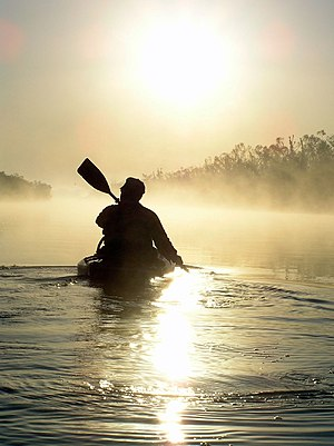 A man paddling in a kayak on the North Canadia...