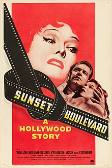 A predominantly red illustration of a older woman's wrathful, enraged face looming large over a frightened younger couple; the title 'Sunset Boulevard' is displayed over a strip of celluloid film tied in a knot.