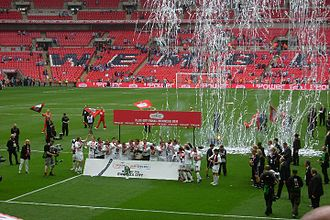 Swansea City A.F.C. - Swansea City celebrate promotion to the Premier League at Wembley Stadium