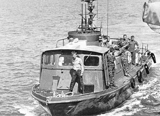Patrol Craft Fast - Swift Boat PCF-71 in Vietnam, showing forward twin .50 caliber (12.7 mm) machine guns directed upward in their secured position.
