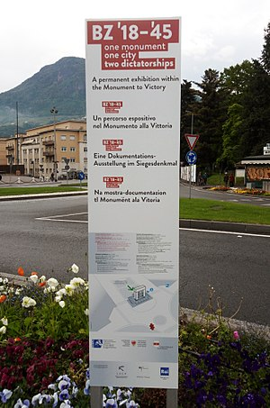 Bolzano Victory Monument - Multilingual signpost of the Permanent Exhibition «BZ '18–'45: One Monument, One City, Two Dictatorships»