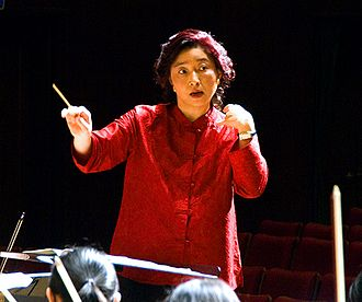 Conducting - Apo Hsu, using a baton, conducts the NTNU Symphony Orchestra in Taipei, Taiwan