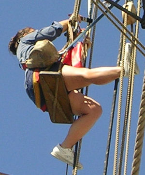 Tarring (rope) - Tarring rope aloft in the rigging of a sailing ship