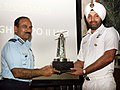 The Chairman Chiefs of Staff Committee (COSC) and Chief of Air Staff, Air Chief Marshal Arup Raha presenting the Best Services Sportsperson Trophy to Harpreet Singh MCPO II of the Indian Navy, in New Delhi.jpg