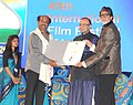 The Chief Guest Superstar Amitabh Bachchan and the Union Minister for Finance, Corporate Affairs and Information & Broadcasting, Shri Arun Jaitley presents the centenary award to Mega Actor Rajnikanth.jpg