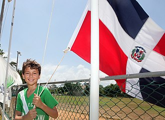 Youth in the Dominican Republic - A young boy holding a flag of the Dominican Republic.