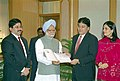 The Minister for Communication & IT Shri Dayanidhi Maran and CMD Sun Network Shri Kalanidhi Maran presenting a cheque of Rs. 5.5 crore to Prime Minister Dr. Manmohan Singh towards PMNRF for Tsunami Victims in New Delhi.jpg