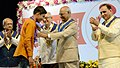 The President, Shri Ram Nath Kovind presenting the Gold Medal to the student, at the 49th Annual Convocation of Veer Narmad South Gujarat University (VNSGU), at Surat, in Gujarat.JPG