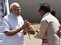 The Prime Minister, Shri Narendra Modi being received by Chief Minister of Madhya Pradesh, Shri Shivraj Singh Chouhan, on his arrival at Jabalpur, Madhya Pradesh on April 24, 2018.JPG