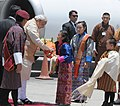 The Prime Minister, Shri Narendra Modi being welcomed by the children, on his arrival at Paro International Airport, in Bhutan on June 15, 2014.jpg
