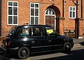 Thomas Wall Centre and London taxi cab, SUTTON, Surrey, Greater London - Flickr - tonymonblat.jpg