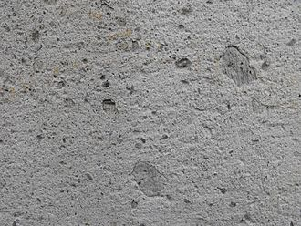 Trachyte - A cut sample of trachyte, with phenocrysts of sanidine, in a wall in Germany