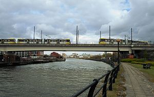 Eccles Line - Two trams crossing the Manchester Ship Canal on Pomona Viaduct.