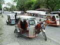 Tricycles waiting for passengers the Philippines.jpg