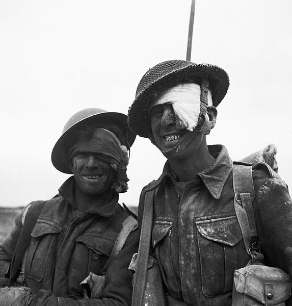 File:Two wounded soldiers from the Durham Light Infantry during the Mareth line battle in Tunisia, March 1943. NA1345.jpg