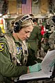 U.S. Air Force 1st Lt. Sandrela El Masry Ruiz, a flight nurse with the 34th Aeromedical Evacuation Squadron, fills out paperwork in a C-17 Globemaster III aircraft during Joint Readiness Training Center (JRTC) 140313-F-RW714-214.jpg