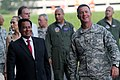 U.S. Army Maj. Gen. James Hoyer, the adjutant general for the West Virginia National Guard, gives Pedro Bravo, the minister counselor with the Peruvian Embassy, and other distinguished visitors a tour of 130718-A-VP195-729.jpg