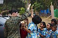 U.S. Marine Corps Lance Cpl. Kassie L. McDole, left, a combat videographer with Marine Corps Forces, Pacific, high-fives students at an elementary school in Phitsanulok province, Thailand.jpg