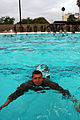 U.S. Marine Corps Sgt. Abel Contreras swims to the edge of the pool using the Butterfly Stroke during his Water Survival Qualification test at the community swimming pool on Marine Corps Air Station Miramar 070906-M-DS479-004.jpg