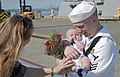 U.S. Navy Ship's Serviceman 1st Class Chris Wiese, right, assigned to the guided missile destroyer USS Momsen (DDG 92), holds his newborn son on the pier at Naval Station Everett, Wash., Aug. 22, 2013 130822-N-MM360-175.jpg