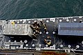 U.S. Sailors with Navy Cargo Handling Battalion 1 secure a shipping container delivered from the vehicle cargo ship USNS Pililaau (T-AKR 304) during the Combined Joint Logistics Over the Shore (CJLOTS) naval 130418-N-LO372-376.jpg