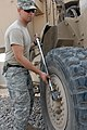 US Army 53569 BAGHDAD - Pasco, Wash. native, Sgt. Luke Mehling, a tank mechanic assigned to Company B, 2nd Battalion, 5th Cavalry Regiment, 1st Brigade Combat Team, 1st Cavalry Division, tightens a bolt after repla.jpg