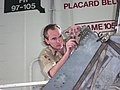US Navy 030503-N-0000X-001 Tim Hoffman, an aerospace engineer from Naval Aviation Systems Command (NAVAIRSYSCOM) Depot North Island, Calif., evaluates damage to a UH-1 Huey.jpg
