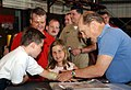 US Navy 030614-N-3122S-002 Robert Duvall autographs the cast for the son of a Sailor.jpg