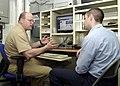 US Navy 040428-N-2716P-001 U.S. Sixth Fleet Command Master Chief James P. Russell helps a junior Sailor understand the Navy Knowledge Online website aboard USS La Salle (AGF 3).jpg