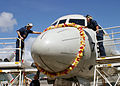 US Navy 040603-N-6501W-055 Sailors assigned to the Golden Swordsmen of Patrol Squadron Four Seven (VP-47), carefully places a flower lei on the nose of a P-3C Orion.jpg