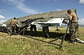 US Navy 040714-N-6811L-048 Navy Divers assigned to Mobile Diving Salvage Unit One (MDSU-1) assemble a tent during a field exercise.jpg