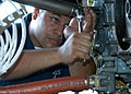 US Navy 040810-N-2645L-006 Aviation Machinist Mate Airman Hector LeonRamo, assigned to Patrol Squadron Sixteen (VP-16), prepares an engine for installation on a P-3C Orion aircraft.jpg