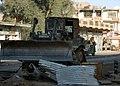 US Navy 041118-N-4388F-003 Equipment Operator 3rd Class Gerry Walker operates a Hi-Tracked bulldozer to clear debris from the streets of Fallujah, Iraq during Operation Al Fajr (New Dawn).jpg
