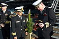 US Navy 041221-N-6490U-001 Commanding officer of aircraft carrier USS Kitty Hawk (CV 63), Capt. Thomas Parker and commanding officer of Japanese Self-Defense Ship Shirane (DDH 143), Capt. Akira Aoki, participate in a traditiona.jpg