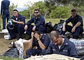 US Navy 050106-N-9593M-083 Sailors assigned to USS Abraham Lincoln (CVN 72) take a well-earned rest during a break in resupply operations at Sultan Iskandar Muda Air Force Base in Banda Aceh, Sumatra.jpg