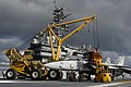 US Navy 050113-N-5781F-041 Crash-and-salvage personnel rig a training skeleton of an F-14 Tomcat to Tilly, a mobile crane used aboard USS Kitty Hawk (CV 63).jpg