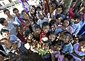 US Navy 050115-N-9951E-146 Children smile and gather for a group photo in the town of Lamno, Sumatra.jpg